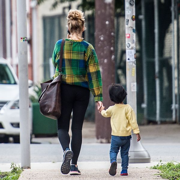 Mother and child walking down the street